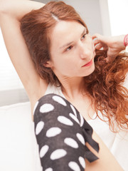 redheaded beautiful slim girl in her living room