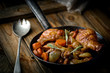 chicken with mushrooms and vegetables, stewed in wine. - 76092306