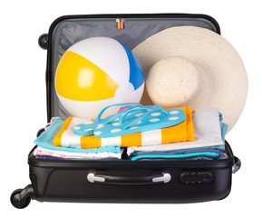 Packed suitcase full of vacation items