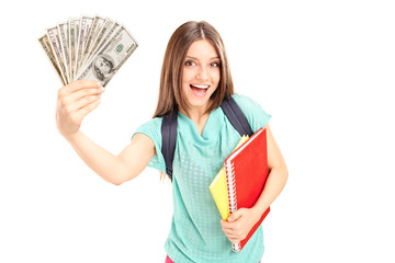 Joyful female student holding money