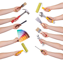 Woman holding redecorating tools isolated on white