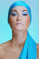 Beautiful woman in turquoise scarf on the head