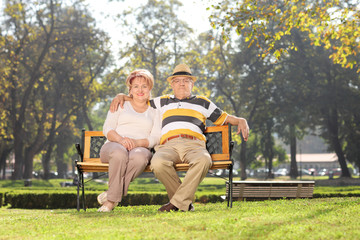 Lovely mature couple relaxing in park