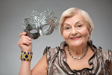 Elderly woman wearing glamorous mask