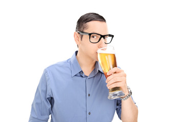 Young guy drinking a pint of beer