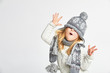canvas print picture - Beautiful blond girl playing in the winter warm hat and scarf on