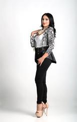 Brunette fashion model posing isolated on white background