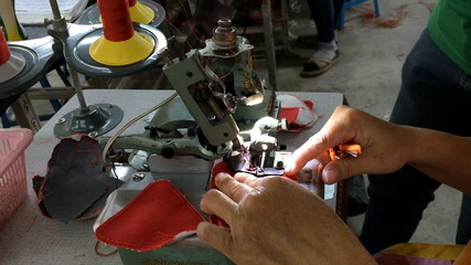 stitching on footwear component with edge-stitch sewing machine