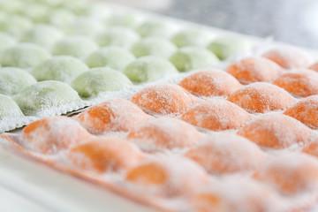 Closeup Of Raw Ravioli Pasta On Cutting Board