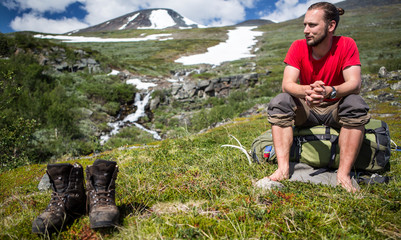 Hiker takes a break on barefoots