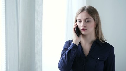 Girl talking on phone hangs up angry