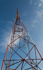 High-voltage tower against blue sky.