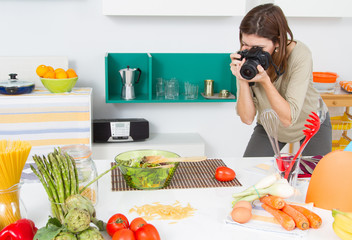 Food Blogger. Woman shooting food in kitchen