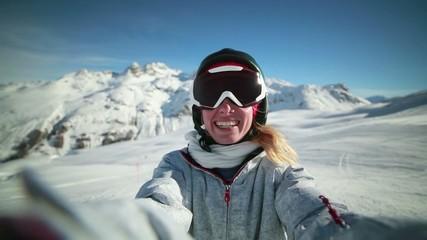 Skier on ski slopes taking a selfie