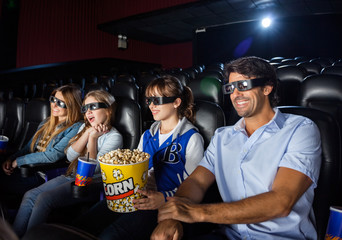 Happy Family Watching 3D Movie In Theater