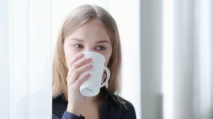 woman drinking tea and eating cookies