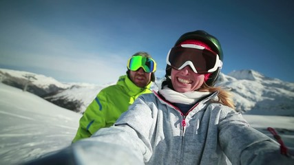 Cheerful couple taking selfie on ski slopes-Winter