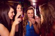 Pretty friends drinking shots together - 76096589