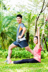 Asian Chinese couple at outdoor fitness training