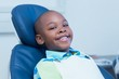 canvas print picture - Smiling boy waiting for a dental exam