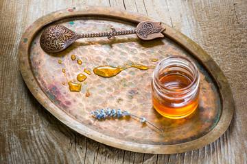 Jar of honey,vintage spoon