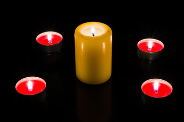 Candles are lit on the table, dark background. Topp view.