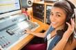 Smiling university student mixing audio - 76098516