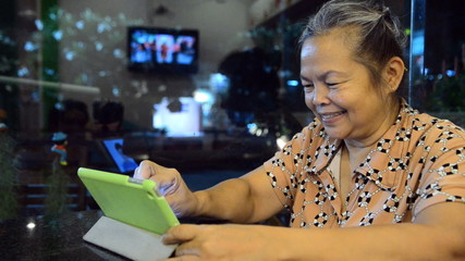 Portrait of old asian people with white hair looking at tablet