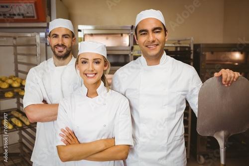 Papiers peints Table preparee Team of bakers smiling at camera