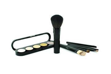 Eyeshadows and brushes isolated on white
