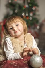 girl holding a Christmas ball