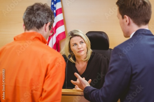 Lawyer speaking about the criminal in orange jumpsuit - 76100583