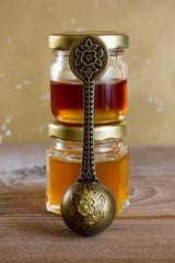 Jars of honey,vintage spoon