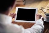 Fototapety Business man working on digital tablet