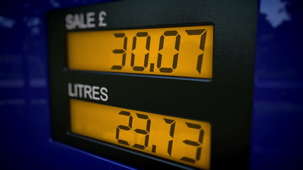 Time lapse on display showing UK petrol price increasing rapidly