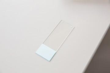 Tester slide on a desk
