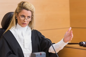 Stern judge speaking to the court