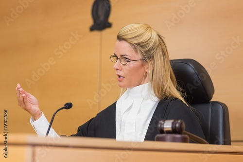 Stern judge speaking to the court - 76102586