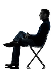 man sitting side view  silhouette full length