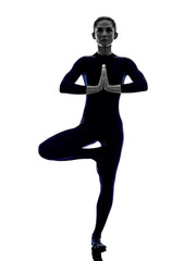 woman exercising Vrksasana tree pose yoga silhouette