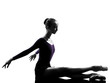 young woman ballerina ballet dancer stretching warming up  silho