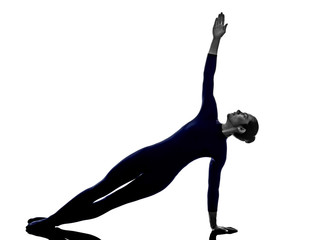 woman exercising Vasisthasana side plank pose yoga silhouette