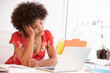 Frustrated Woman Working At Desk In Design Studio