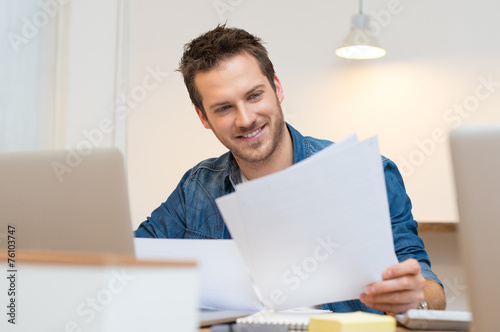 Businessman checking document - 76103747