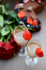 Champagne Glasses with Strawberries and Bunch of Flowers