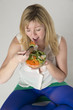 Woman eating helathy food a salad take away meal