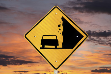 Falling Rocks Warning Sign with Sunrise