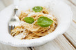 Pasta with cheese and green basil