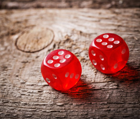 Pair of thrown red dices on old wooden table