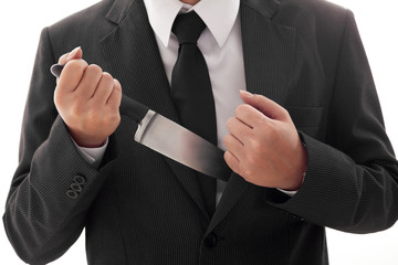 Businessman Holding Knife ready to attack Isolated